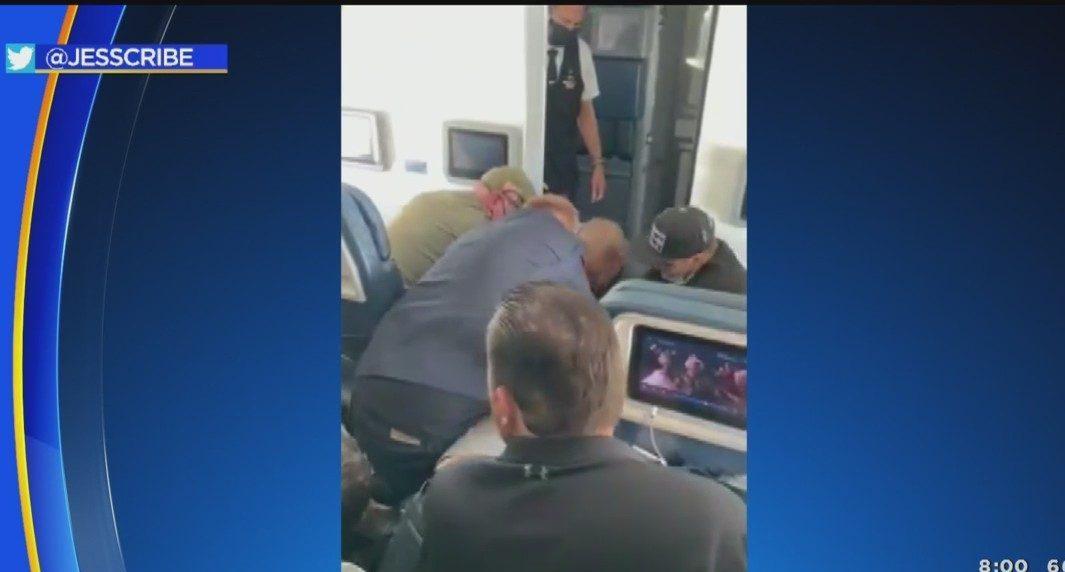 FLIGHT DIVERTED: Sheriffs spokesman on arrests, passenger