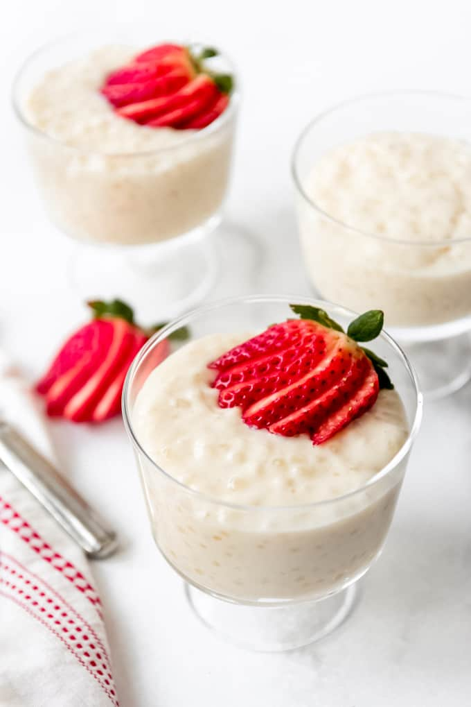 A fanned strawberry on top of homemade tapioca pudding.