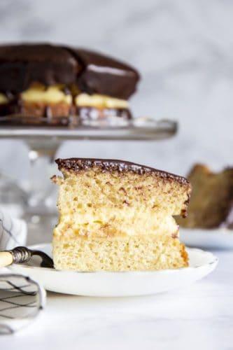 A slice of Boston Cream Cake on a plate.