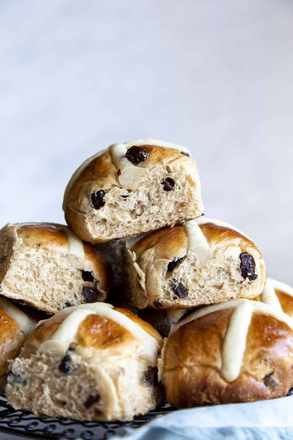 Soft fluffy Hot Cross Buns in a stack.