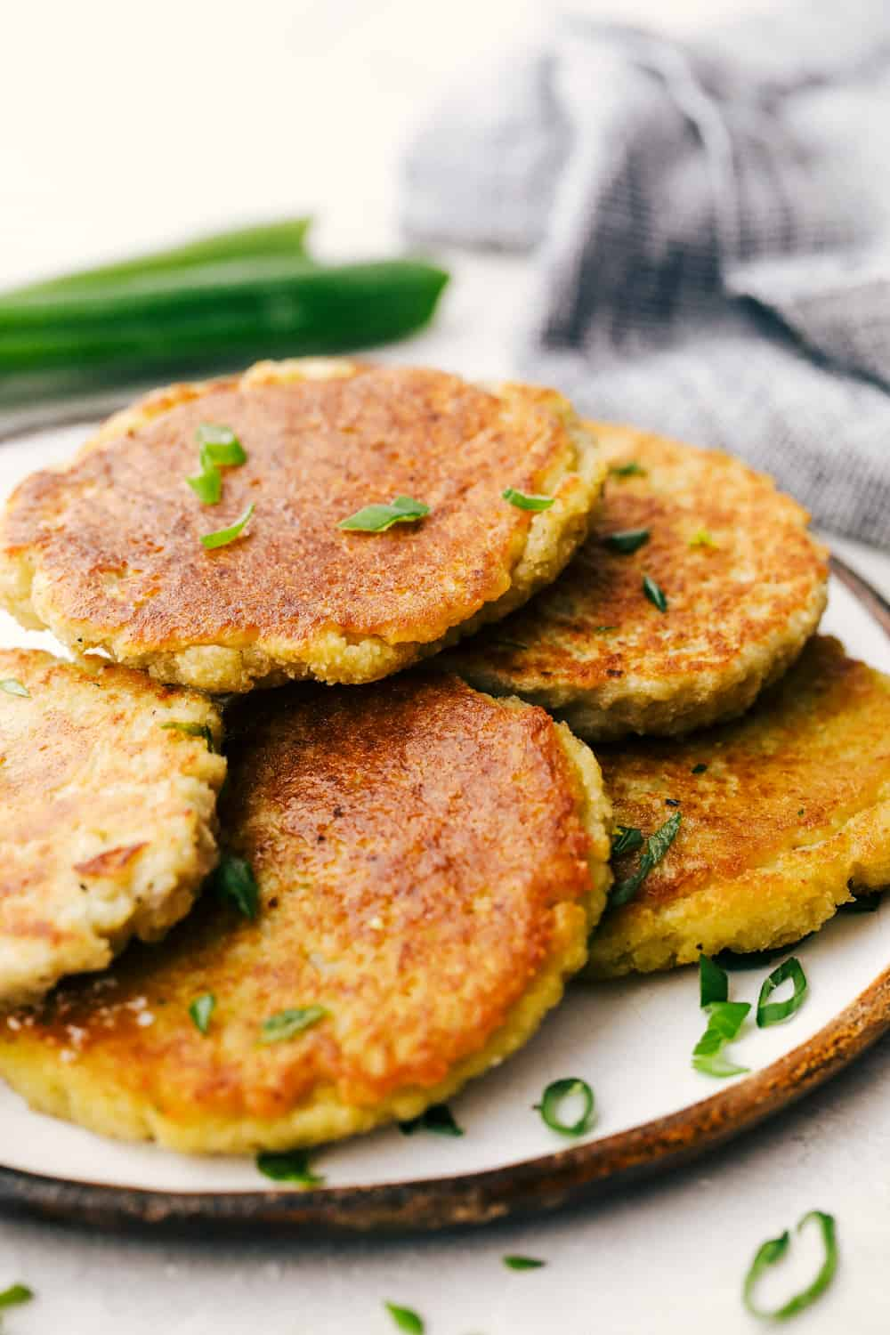Potato pancakes with some garnish on a plate.