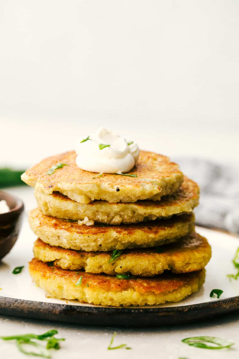 Potato pancakes stacked with a dollop of sour cream.