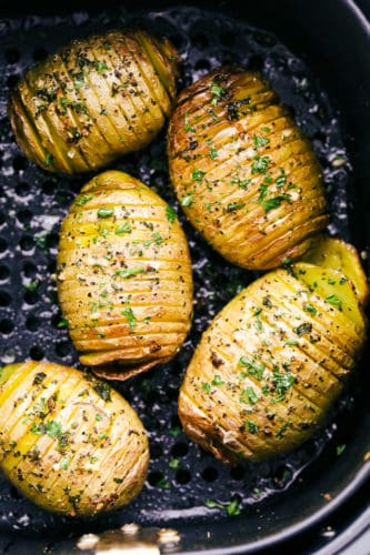 Hasselback potatoes in the air fryer with herbs and salt.
