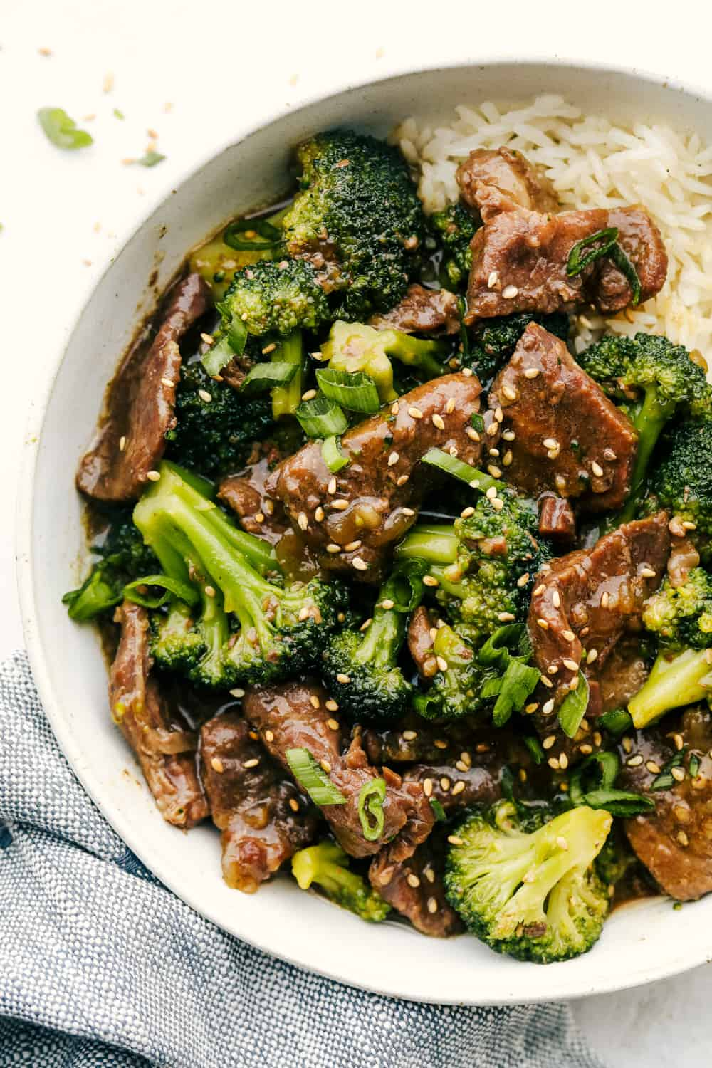Slow Cooker Beef and Broccoli with rice in a bowl.