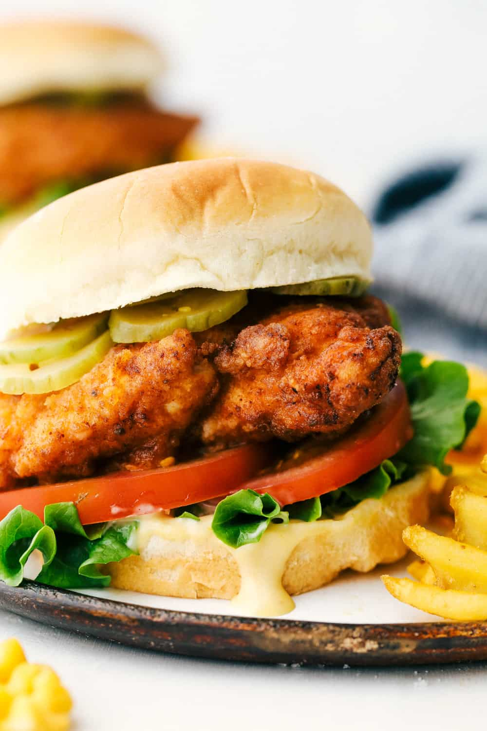 Chicken Sandwich with pickles and chick-fil-a sauce on a plate.