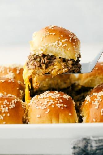 Lifting a cheeseburger slider out of a pan!