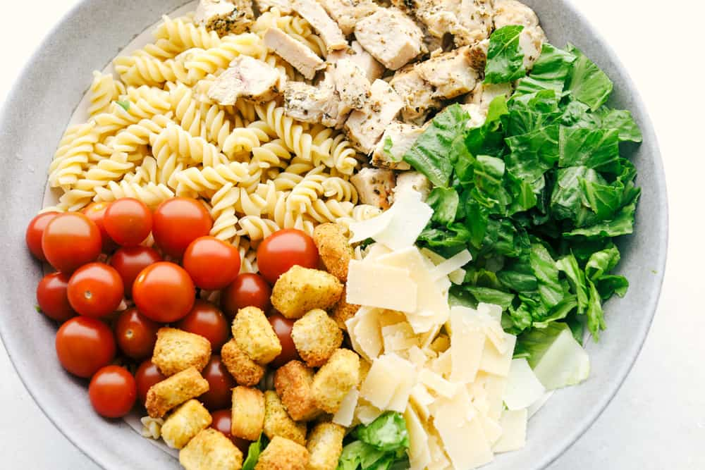 All the ingredients for Chicken Pasta Caesar Salad ready to be mixed.