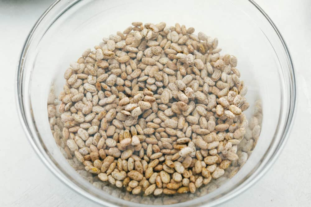 Soaking dried beans in a glass bowl.