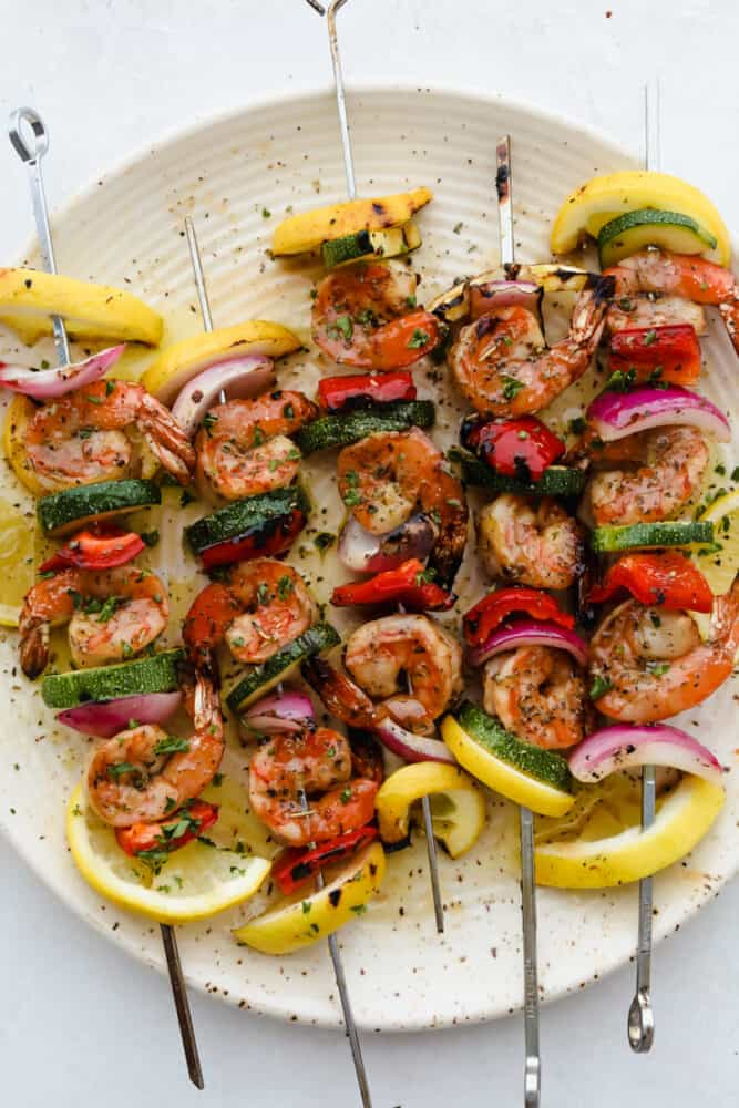 Grilled marinated shrimp on skewer with veggies.