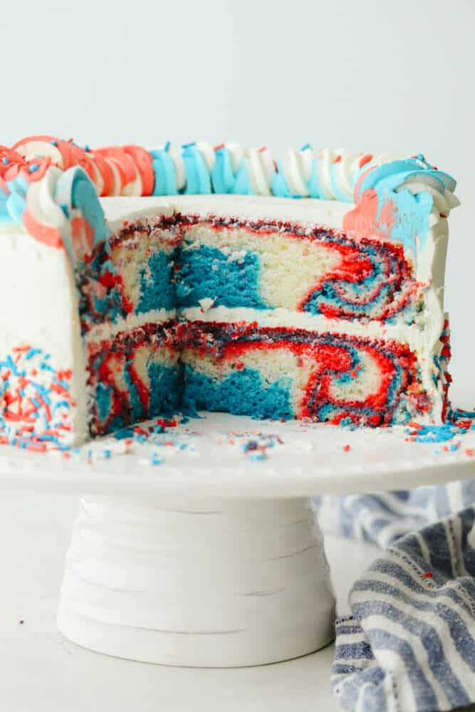 The red, white, and blue cake sliced so you can see the inside.