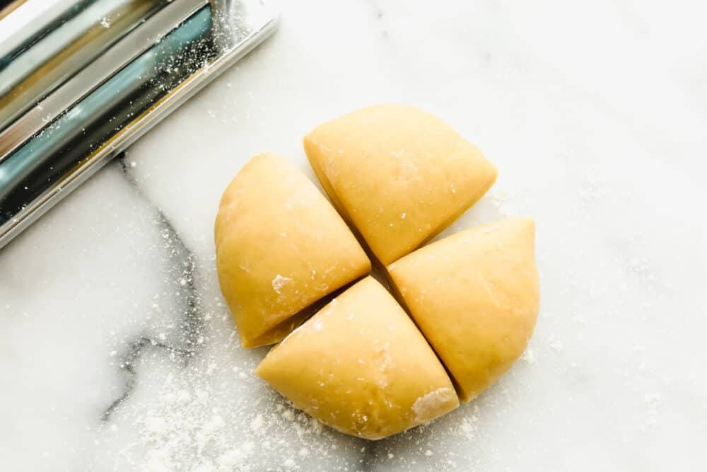 Cutting rested dough into quarters.