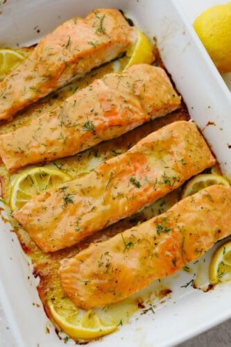 Baked salmon in a casserole dish.