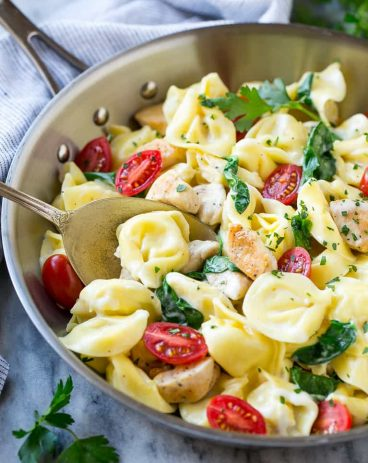 This one pot chicken with tortellini is a family friendly meal that's ready in no time! It's packed full of golden brown chicken, veggies and tortellini, all in a creamy parmesan sauce.
