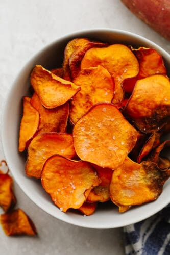 Air fryer sweet potato chips in a bowl.