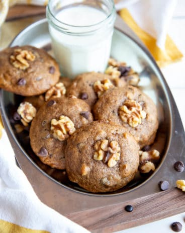 Banana cookies on a serving tray with milk